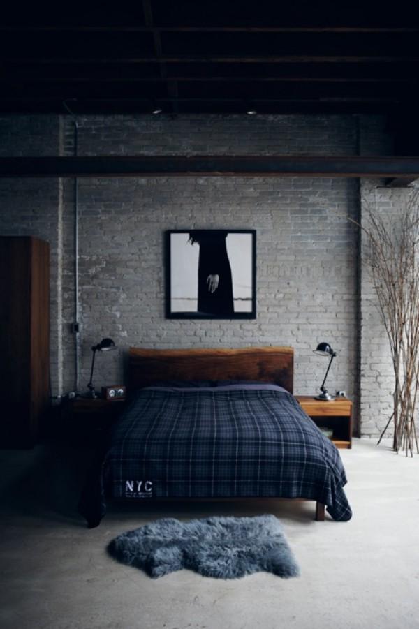 Backsteinwand im Schlafzimmer moderne Gestaltung in Grau und Dunkelblau sehr ansprechendes Ambiente