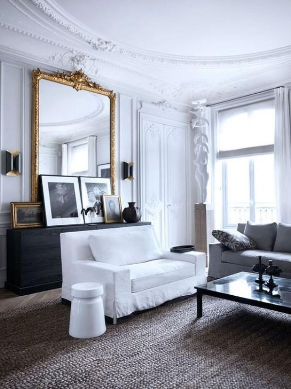 Pariser Chic im Wohnzimmer weiße Couch Bilder Wohnaccessoires mit Geschichte