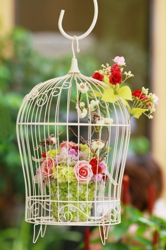 vogelkäfig deko mit kunstblumen