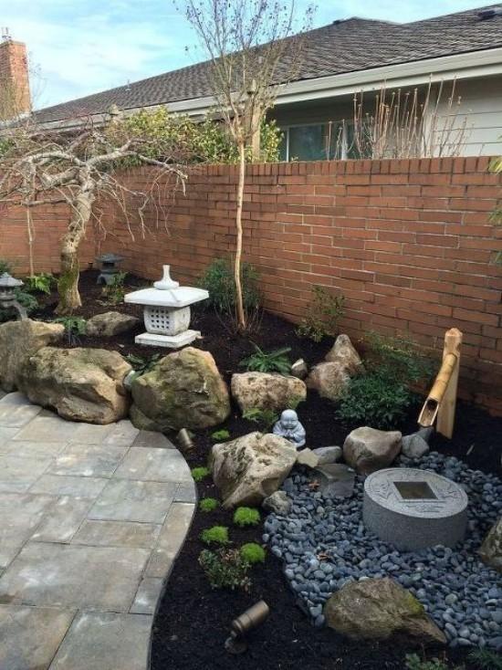 Japanischer Garten hohe Ästhetik visuelle Harmonie Steine Kies Laterne Buddha-Figur aus Stein