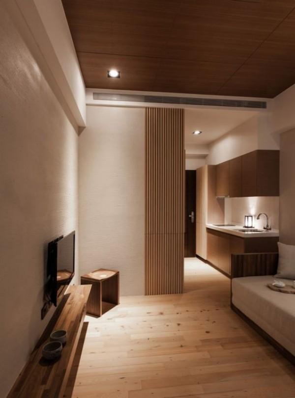 Japanisches Wohnzimmer Bambus Schiebetüren trennen Küche von Sitzecke ab viel Holz helle Wände