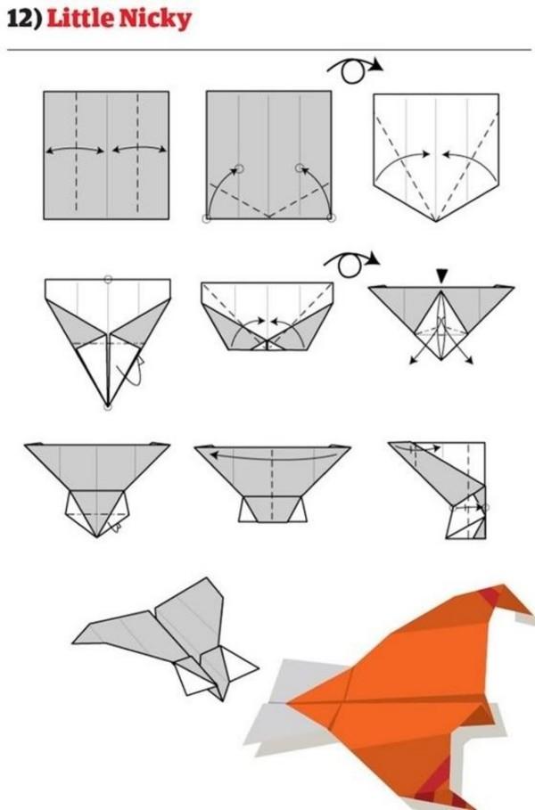 Papierflugzeug in toller orangenen Farbe