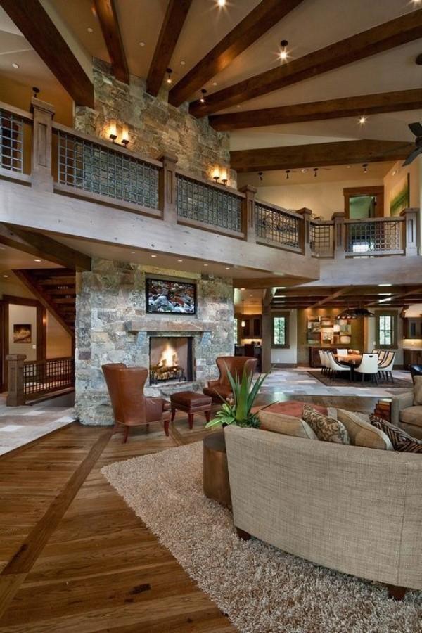 Scheune umbauen Steinwand um den Kamin oberes Wohngeschoss viel Komfort