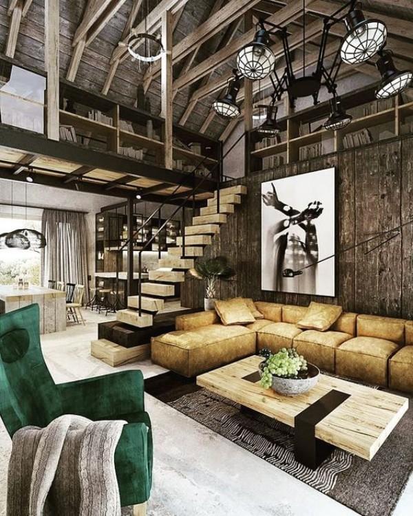 Scheune umbauen frei gelegte Balken Treppe moderne Möbel auffällige Lampen Bücherregale Wände aus Holz
