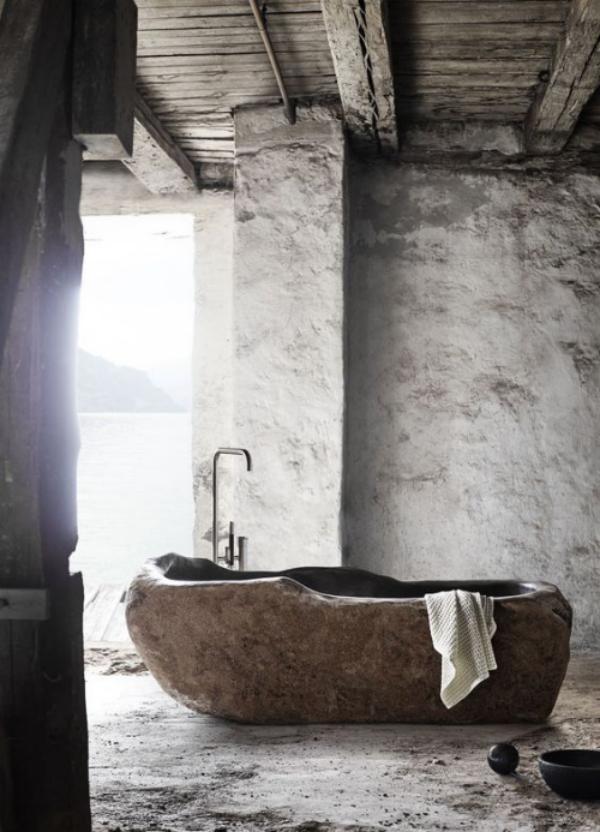 Stein im Bad Badewanne aus Stein organische Form natürliche Textur