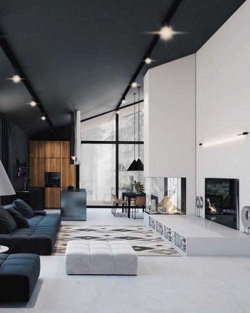 Wohnzimmer in Schwarz-Weiß niedrige elegante Möbel hohe Decken Glasfenster Kamin Fernseher viel Charme Raffinesse