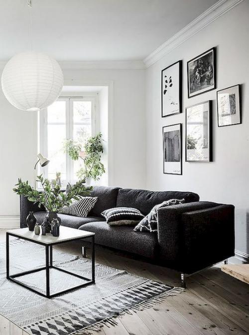 Wohnzimmer in Schwarz-Weiß schicke Raumgestaltung wenige Möbel