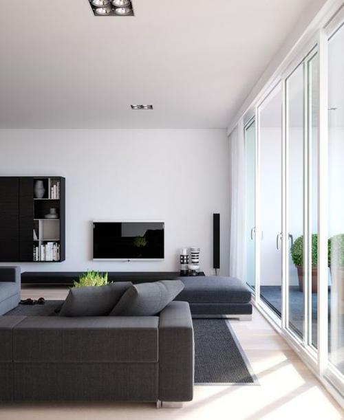 Minimalismus im Wohnzimmer Ecksofa in Grau schlichtes Design