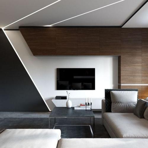 Minimalismus im Wohnzimmer geometrische Formen klare Linienführung typisch für den Stil eingebautes Licht