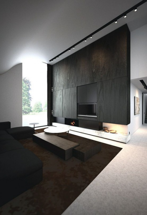 Minimalismus im Wohnzimmer großer Raum perfektes Design dunkle Farbtöne mit Weiß und Grau kombiniert