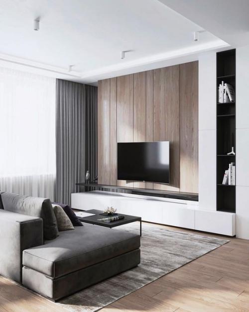 Minimalismus im Wohnzimmer perfektes Design bequemes Sofa in Grau Flachfernseher Teppich Gardinen alles im visuellen Einklang