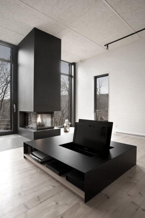 Minimalismus im Wohnzimmer perfektes Raumdesign Säule mit Bio Kamin viel Tageslicht Medientisch als Zentralstück