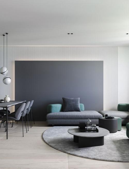Minimalismus im Wohnzimmer typisches Farbschema sanfte Graunuancen zwei Tupfer in Pastellgrün