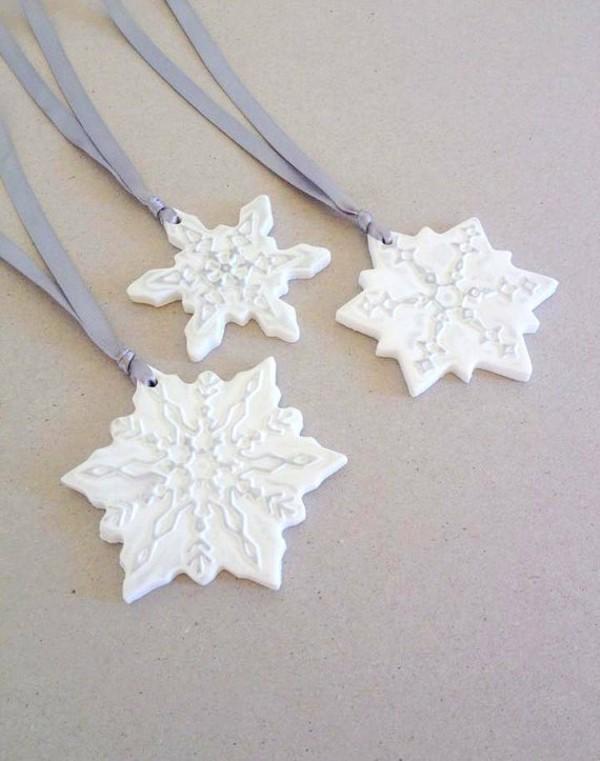 Weihnachtssterne basteln Fimo Ideen DIY Weihnachtsdeko Sterne Schneeflöcken