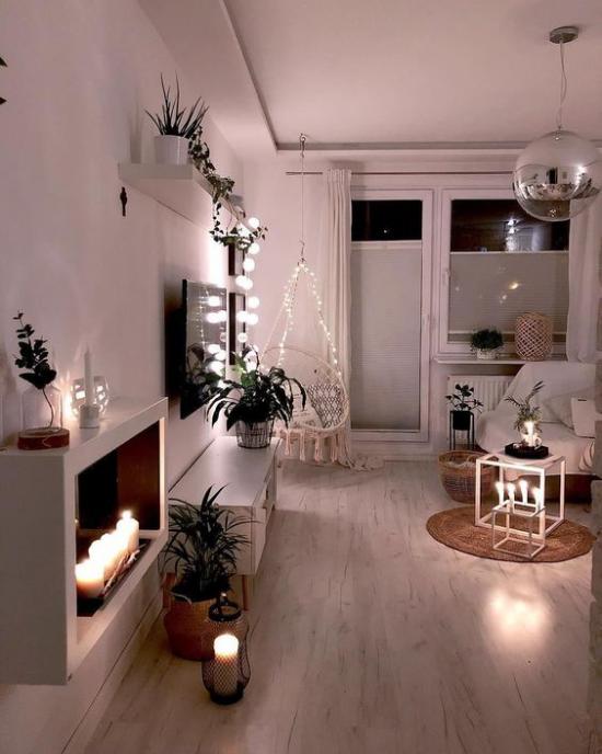 Winterdeko im Wohnzimmer richtige Beleuchtung Kerzen Lichterketten eine sehr romantische Atmosphäre schaffen