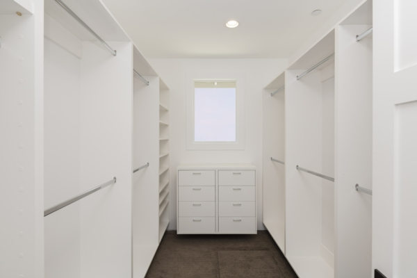 Big empty walk in wardrobe / closet in luxurious house.