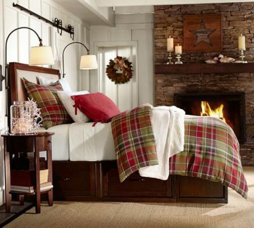 Gemütliches Schlafzimmer im Winter gestalten Kamin Steinwand Karomuster warme Bettwäsche Kissen Lampen