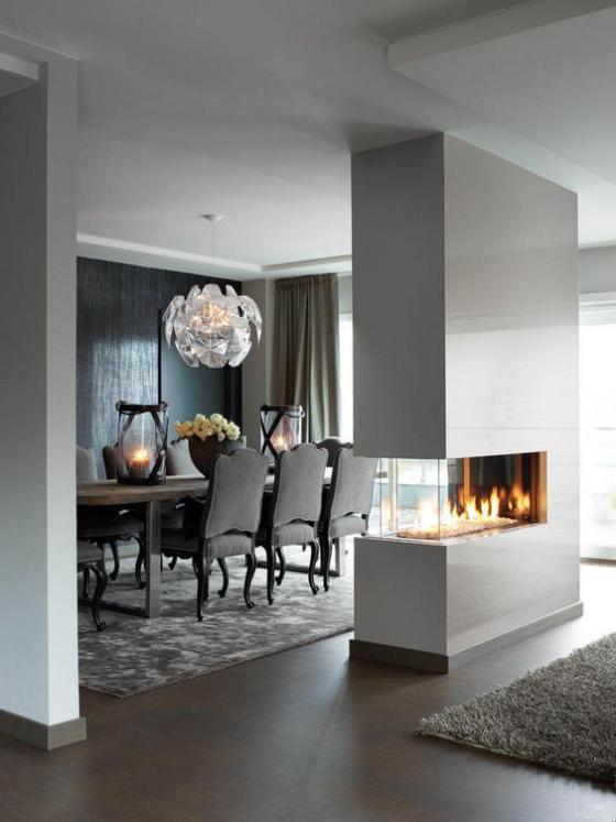 Moderne Kamine ein eingebauter doppelseitiger Kamin minimalistisches Design