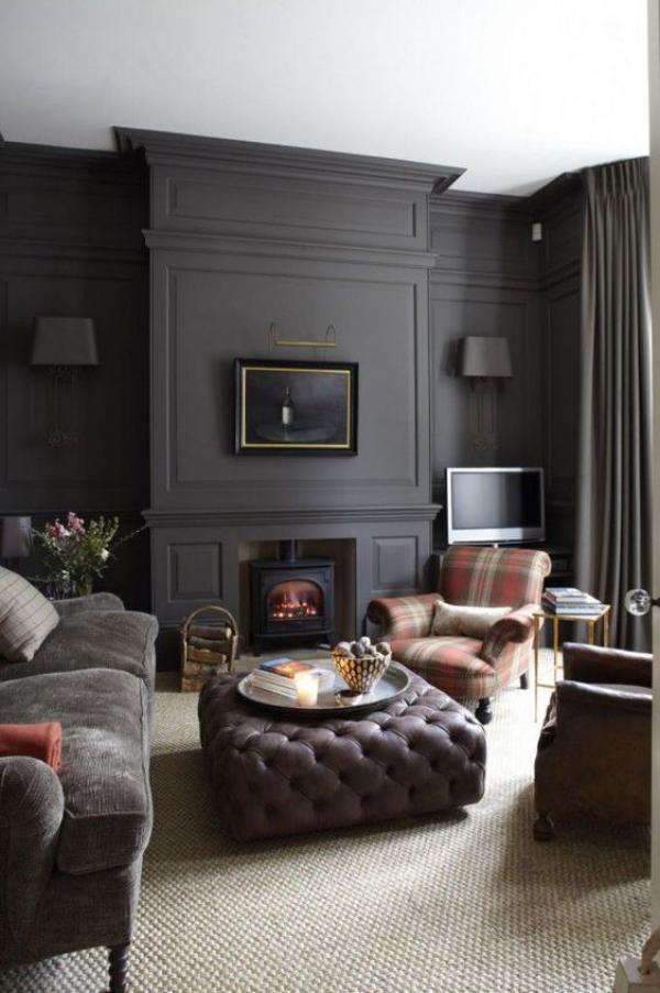 Aktuelle Farbpaletten im Wohnzimmer 2020 grau dominiert karierter Stoff Sessel Kamin Sofa