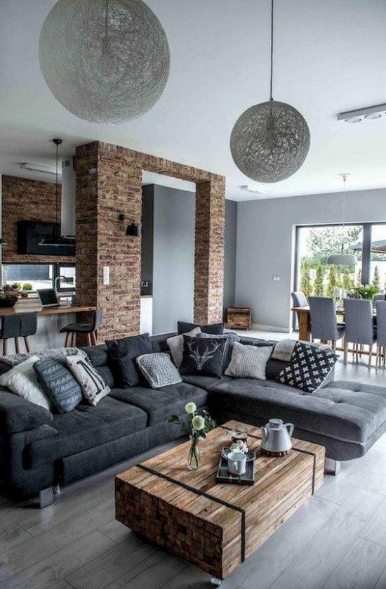 Wohnzimmer optisch erweitern offenes Raumkonzept Grau dominiert Holzkiste als Blickfang Ziegelwand