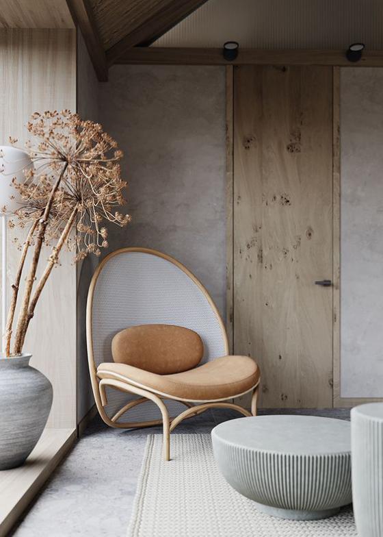 Zeitgemäße Raumgestaltung helles einfach gestaltetes Ambiente runder Stuhl runde Formen ziehen die Blicke an