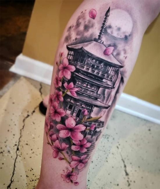 sakura kirschblüten tattoo unterschenkel mit tempel