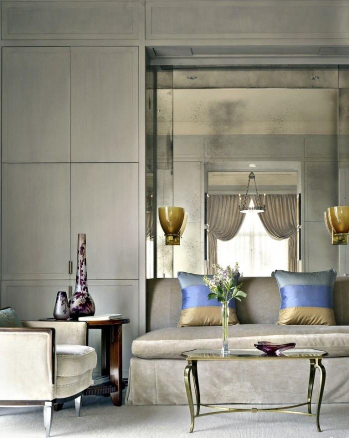 Geheimnisse des Innendesigns enthüllt gemütliche Ecke am Fenster Wohnzimmer in Grau kleine bunte Akzente