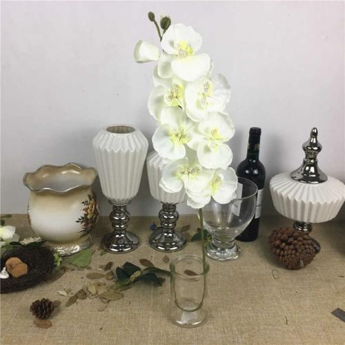 Tischdeko mit Orchideen Hausdekoration weiße Orchideen