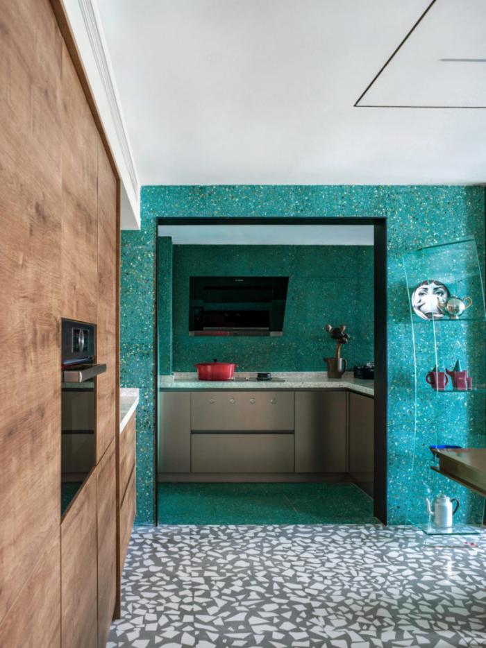 Designerwohnung in China Küche Essbereich ein sanfter Grünton an der Wand bezaubert die Sinne