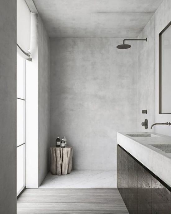 Baddesigns in Grau Industrial Style Betonboden Duschecke Baumstamm für Badkosmetik