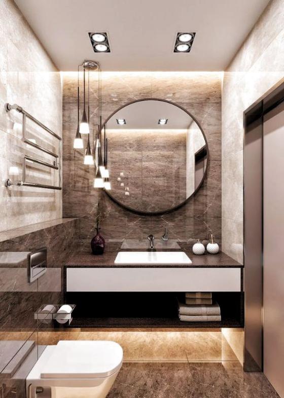 Braun modernes Badezimmer runder Spiegel Großformat Marmorfliesen gute Beleuchtung