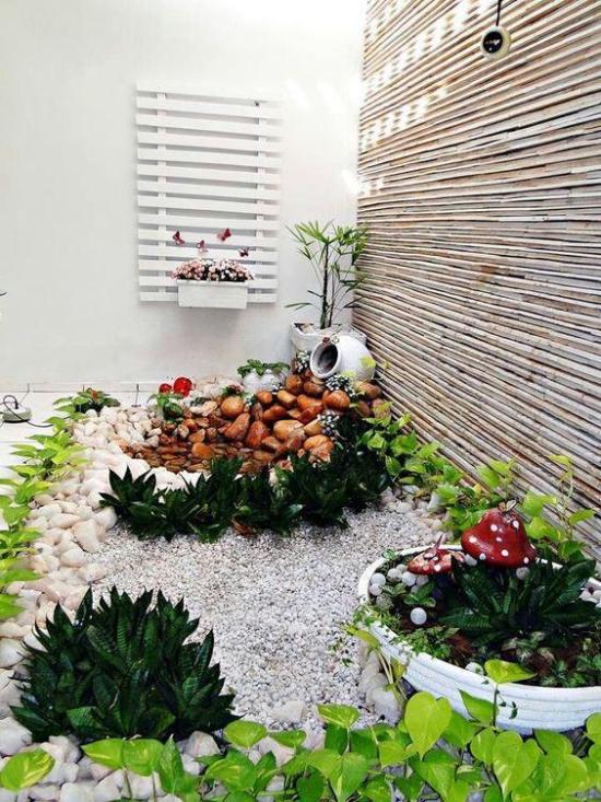Gartengestaltung Kiessteine und Pflanzer