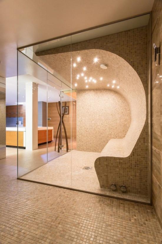 Heimsauna modernes Design ausgefallene Formen hinter Glaswand eingebaute Beleuchtung