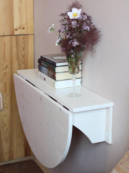 Klapptisch clevere Ideen für klappbare Möbelstücke halbierte Fläche nach Bedarf benutzen Bücher Vase mit Blumen