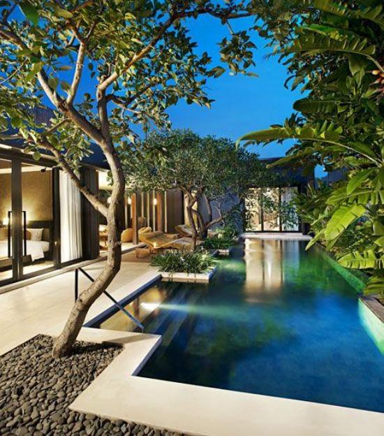 Schwimmbad und Kiessteine - mdoerne Gartengestaltung