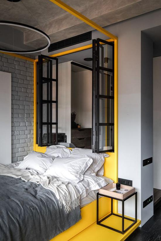 Schlafzimmer Ideen in Grau und Gelb attraktive Raumgestaltung Sonnengelb Schwarz Fensterrahmen graue Bettwäsche gelb am Boden an der Wand
