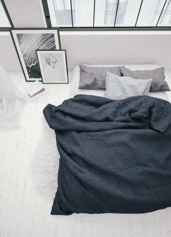 Schlafzimmer minimalistisch einrichten drei Farben vorherrschen Weiß Grau Schwarze Schlafbett