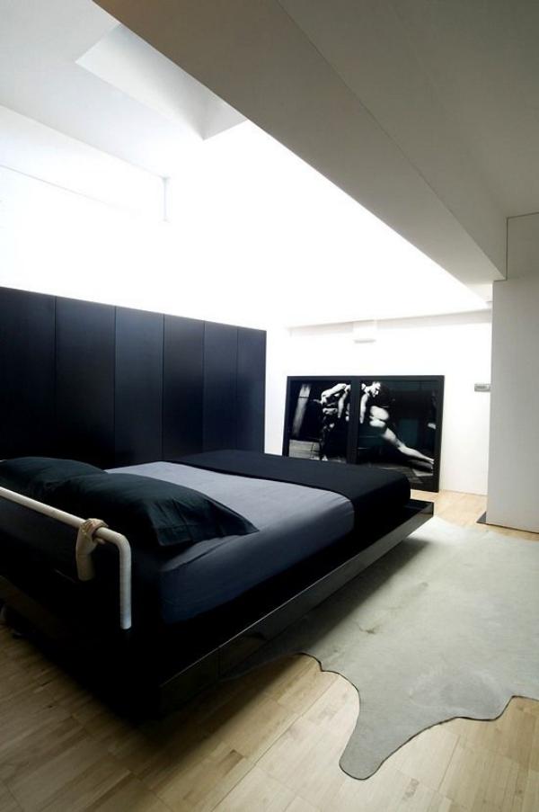 Schlafzimmer minimalistisch einrichten schwarzes Bett etwas Extravaganz mitbringen