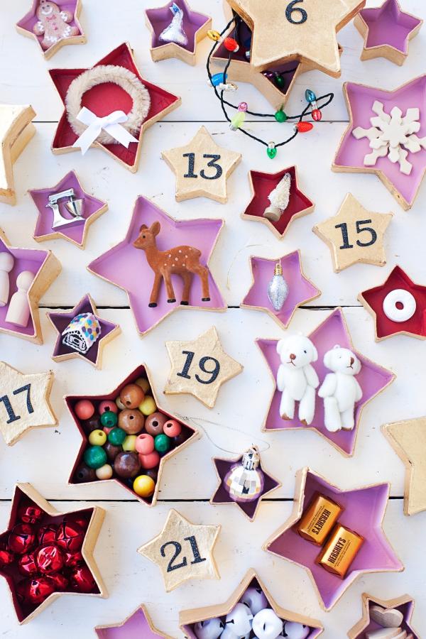 Ausgefallene Adventskalender selber basteln – Ideen und Anleitungen kalender girlande schachteln gold sterne
