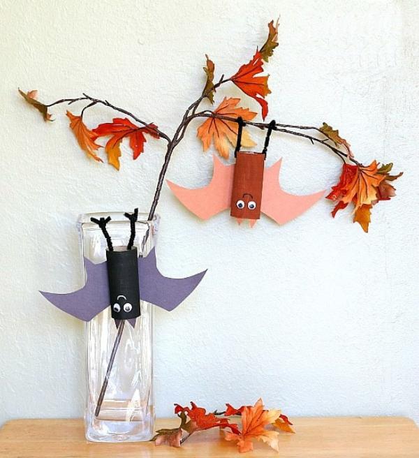 Fledermaus basteln mit Kindern zu Halloween – 50 bezaubernde Ideen und Anleitungen bunte kleine fledermäuse deko zweige