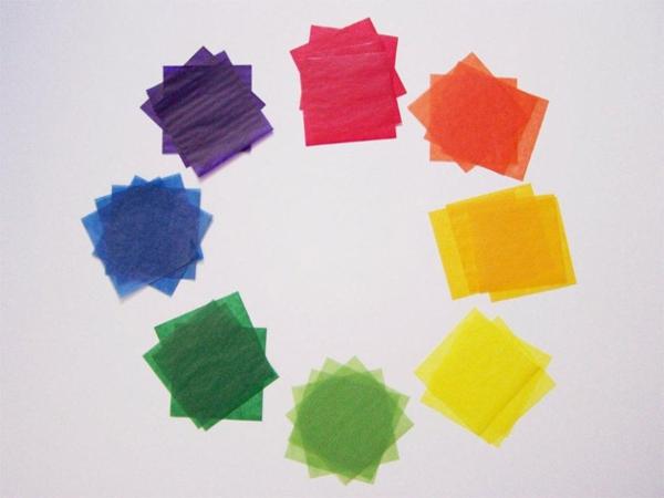 Faltsterne basteln Papierstern farbiges Drachenpapier Quadrate