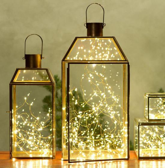 Laternen Weihnachtsdeko drinnen und draußen drei Deko Laternen mit LED Lichterketten geschmückt glänzend schön aussehen