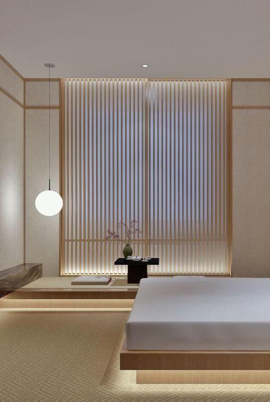 Zen Schlafzimmer ausgewogene Raumatmosphäre Ruhe minimalistische Raumgestaltung abgedunkeltes Fenster eine Hängeleuchte