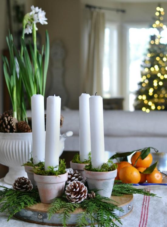 adventskranz basteln weiße kerzen tannengrün zapfen blumentöpfe