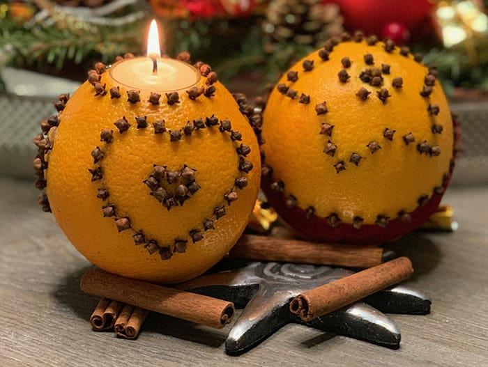 weihnachtskerzen selber machen adventsteller orange nelken