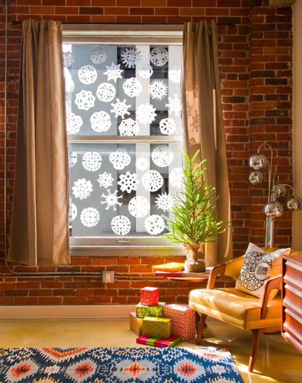 Fensterbilder basteln zu Weihnachten – zauberhafte Ideen und Anleitungen papierschnitte fensterdeko kaffeefilter
