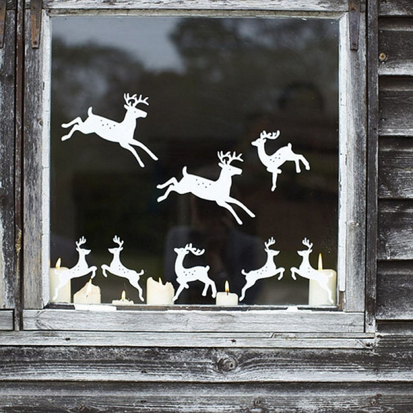 Fensterbilder basteln zu Weihnachten – zauberhafte Ideen und Anleitungen rentiere papierschnitte deko diy