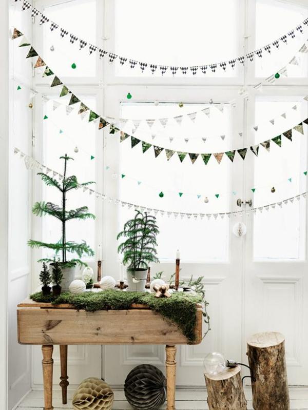 Fensterdeko zu Weihnachten Girlanden aufhängen