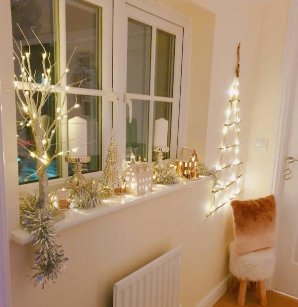 Fensterdeko zu Weihnachten Sterne Lichterketten Kerzen Dekoideen