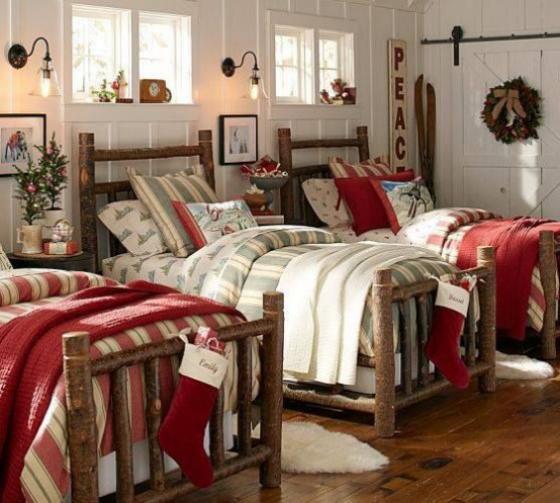 Kinderzimmer weihnachtlich dekorieren im rustikalen Stil drei Kinderbetten Wandkranz